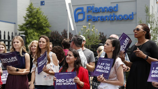 Anti-abortion advocates gather outside the Planned Parenthood clinic in St. Louis in June, 2019.