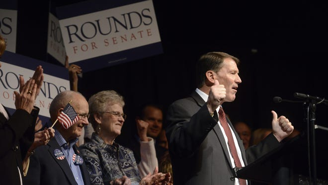Mike Rounds celebrates winning a U.S. Senate seat Tuesday at a Republican election night party at The District in Sioux Falls.