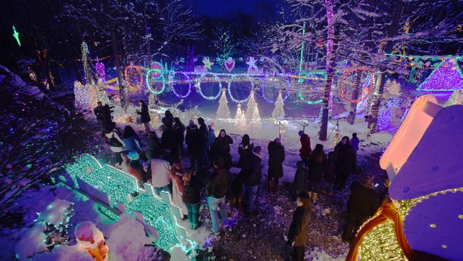 Guinness World Record officials and others gathered at the Gay household for the certification for the most Christmas lights at a residential property on Friday in Union Vale.