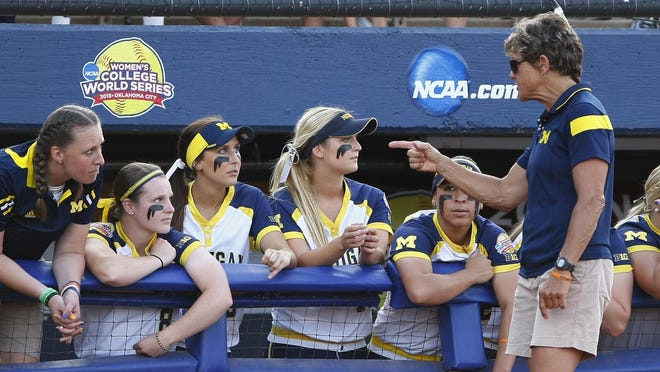 Michigan coach Carol Hutchins talks to her plays during the fourth inning against Florida in Game 2 of the finals in the NCAA softball Women's College World Series, Tuesday, June 2, 2015, in Oklahoma City. (AP Photo/Alonzo Adams)