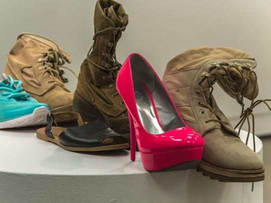 """100 (and 60) Boots, with Grass"" by Matthew Boulay is an installation of women's combat boots paired with civilian shoes that represent the 160 American women who have died while serving as soldiers since 2002. ""Matthew Boulay: Art Show"" is on exhibit through Feb. 5 at Gretchen Schuette Art Gallery, Chemeketa Community College."