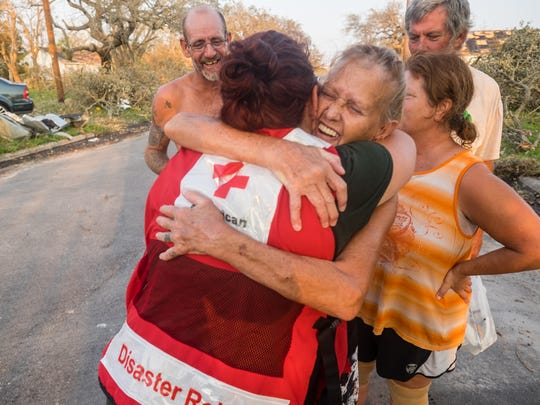 Red Cross volunteers bring a hot dinner to the home of Suzzan and Roy in Port Aransas, Texas, on Aug. 31.