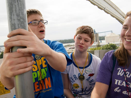 Boonville Middle School students Keith Russ, 14, left, and Alexis Pfeiffer, 13, center, take a ride on the Big Wheel Ferris wheel at the West Side Nut Club Fall Festival Special Kids Day Tuesday morning. Their teacher, Wanda Schwartz, accompanied them on the ride.