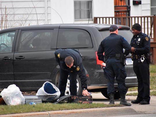 In this Wednesday, April 18, 2018 photo, officers investigate