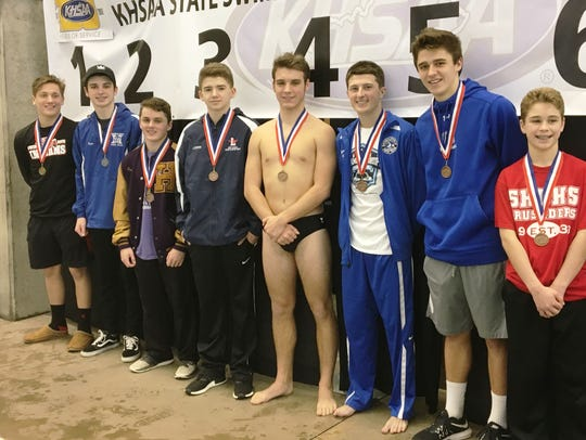 State diving medalists: Gus Staubitz of Holy Cross,