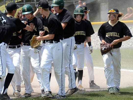 Howell's Nick Rauch is mobbed by teammates after hitting