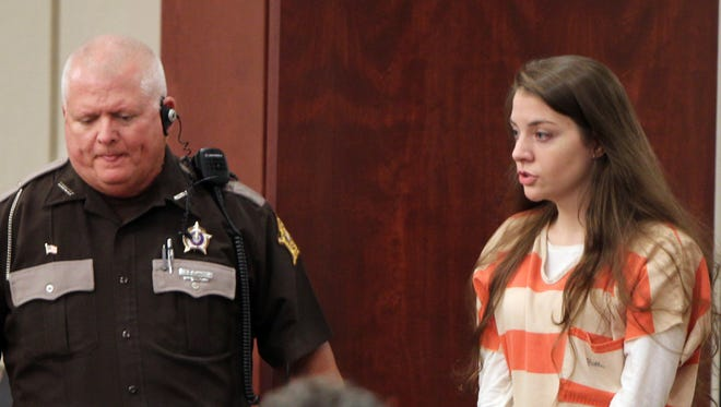 Shayna Hubers enters Campbell Circuit Court  for a hearing in August requesting a new trial based on a juror's failure disclose a felony conviction on a jury questionnaire form.