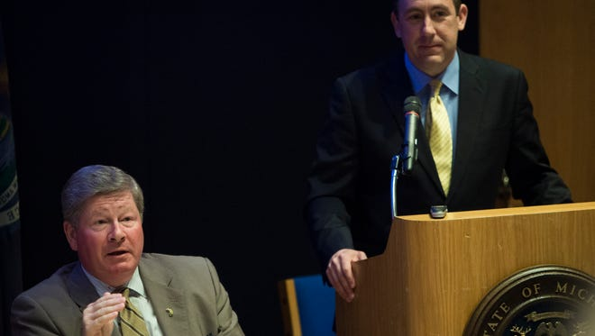 Rich Baird, left, a senior advisor to Gov. Rick Snyder, addresses a state employee engagement seminar on June 21, 2017 at the Library of Michigan, as Jeff Bankowski, head of Snyder's Office of Performance & Transformation, looks on. Baird and Bankowski are part of a committee leading an unprecedented statewide risk assessment of problems in state government.