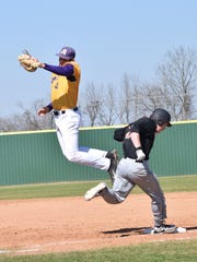 LSU at Alexandria's first baseman Nick Ber (42, left) leaps to catch the ball as Doane College's Nathan Sliva (25, right) reaches first.