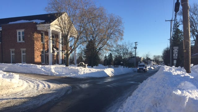 The roads along Main Street in Stewartstown in front of J.J. Hartenstein Mortuary were passable Sunday afternoon.