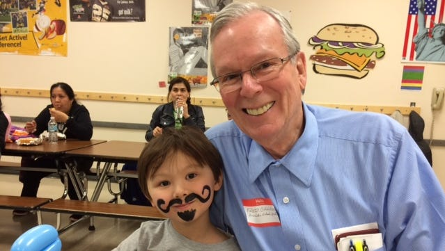 Fred Cruckson and his grandson, Peter Cruckson, take part in a new approach to learning at  Riverside Elementary School in Fond du Lac that has increased parent involvement and student achievement.