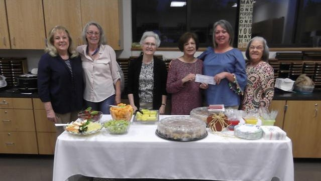 Altrusans Happy Collins, Becky Grainger, Jan Klassen, Barbara Pollack, Lita Warmbold and Ruth Thompson present a donation for the Bowie Elementary School literacy project at a teacher appreciation breakfast at the school.
