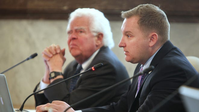 Council members David Mann, left, and Chris Seelbach,  ask question during the pension discussion during the Budget and Finance Committee meeting Monday.