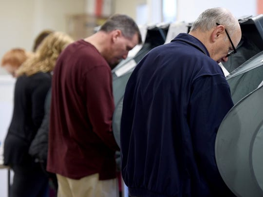Dave Rivoira casts his early voting ballot at the Downtown West location Feb. 19, 2016.