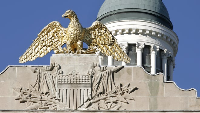 A golden eagle watches over the south side of the Indiana Statehouse in Indianapolis, shown on Wednesday, November 11, 2009.