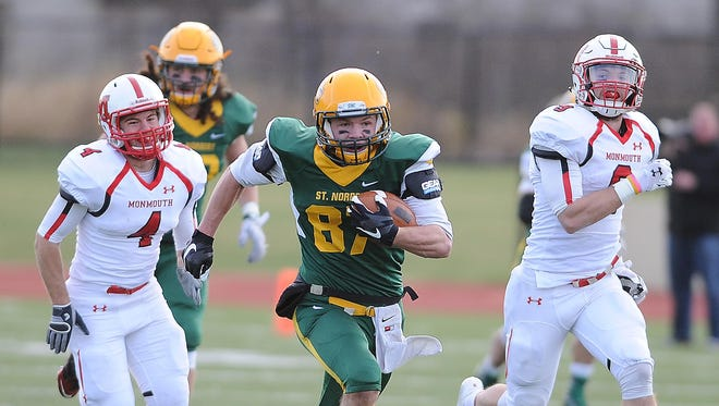 St. Norbert College receiver Zach Reeves (87) runs for yardage against Monmouth College in the Midwest Conference Championship game on Saturday.