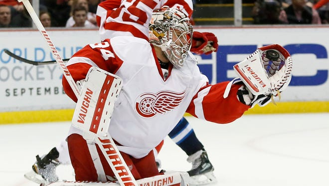 Red Wings goalie Petr Mrazek (34) stops a shot by the Winnipeg Jets during the third period of the Wings' 3-2 win over the Jets Thursday at the Joe Louis Arena.