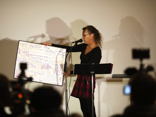 "Lindsey Deaton shows a poster of ""Hope Notes"" for Leelah Alcorn during a press conference at the Woodward Theater on Dec. 28 - the one-year anniversary of Leelah Alcorn's death."