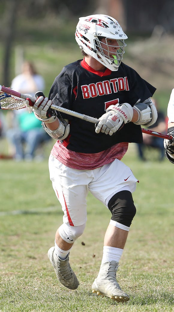 Boonton's Ryan Lourick looks to pass in a game at North