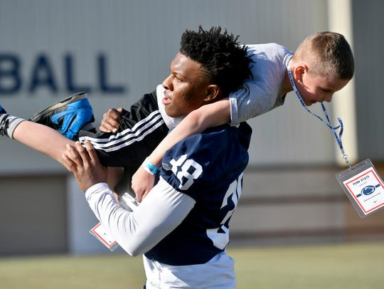 Penn State rookie Lamont Wade, shown here helping at