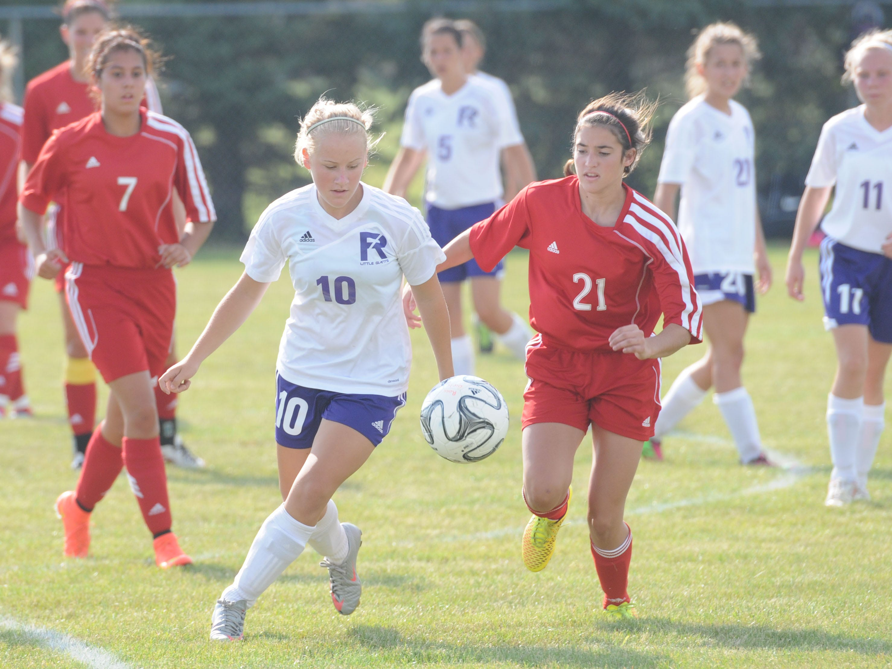 Fremont Ross' Meagan Lilley and Port Clinton's Abbey Weldon fight for possession of the ball during Wednesday's game at Fremont Ross.