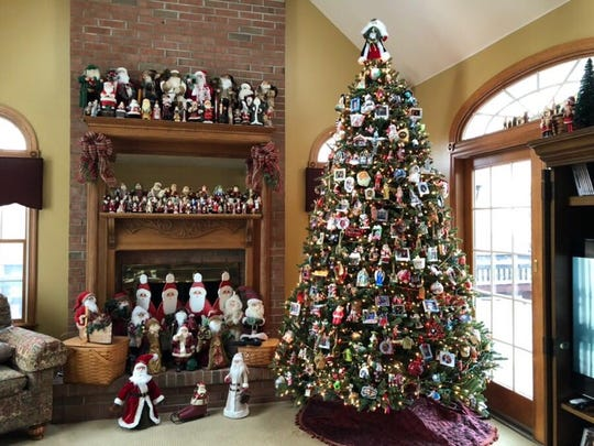 Over o700 Santas are displayed at Sherry & Al Metauro's house in Hillsborough.