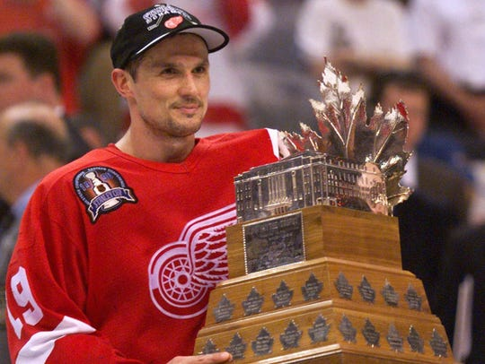 Red Wings captain Steve Yzerman receives the Con Smythe Trophy for the most valuable player in the playoffs after defeating the Capitals, 4-1, in Game 4 of the Stanley Cup finals June 16, 1998 at the MCI Center in Washington.