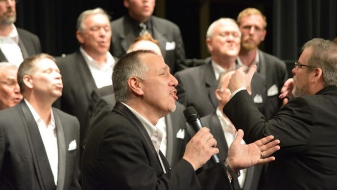 """Will Fox, the Oregon SenateAires's assistant director, sings a solo in """"Bring Him Home"""" from """"Les Misérables."""" The Salem-based barbershop chorus won the Evergreen District's Division IV Contest on Saturday, April 9, in Eugene."""