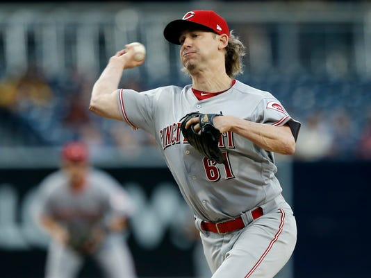 Cincinnati Reds starting pitcher Bronson Arroyo throws to the plate during the first inning of a baseball game against the San Diego Padres in San Diego, Monday, June 12, 2017. (AP Photo/Alex Gallardo)