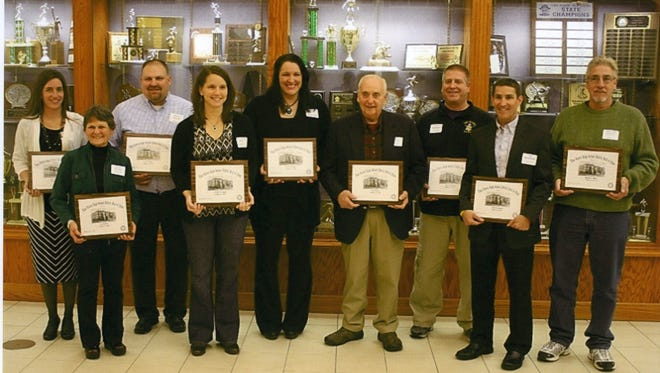 Recent inductees into the Two Rivers High School Athletic Hall of Fame, left to right, Amy Gallagher, Helen Bleser accepting for Don Bleser, Brian Miller, Becky Lueck, Denee Mott, Tom Steltz, Rick Peterson, Tim Broderick and John Miller accepting for Shanna Shelton. Inductee Craig Strohm was unable to attend the event.