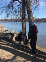 Cary Alexyn and daughter Kylie Alexyn feed ducks at Irondequoit Bay State Marine Park on March 23, 2017.
