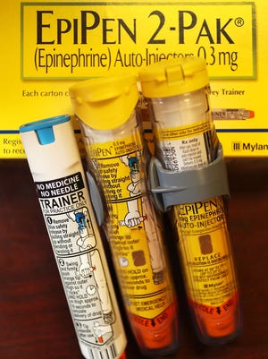 This is a photo illustration of an EpiPen, which dispenses epinephrine through an injection mechanism for people having a severe allergic reaction.