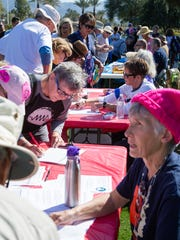 """Volunteers are stationed at tables at the """"Not My President's"""