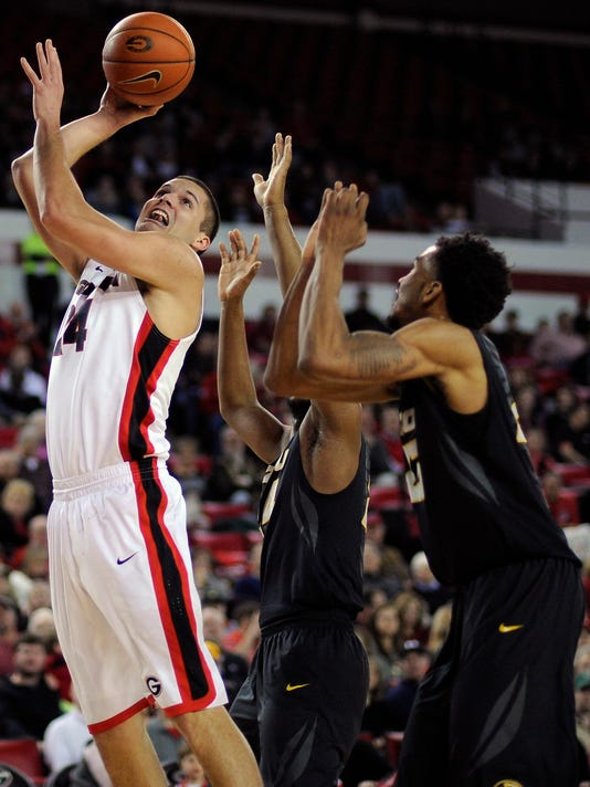 Georgia forward Houston Kessler (24) looks for a shot during the first half of an NCAA college basketball game against Missouri on Wednesday, Jan. 6, 2016, in Athens, Ga. (AJ Reynolds/Athens Banner-Herald via AP) MAGS OUT; MANDATORY CREDIT