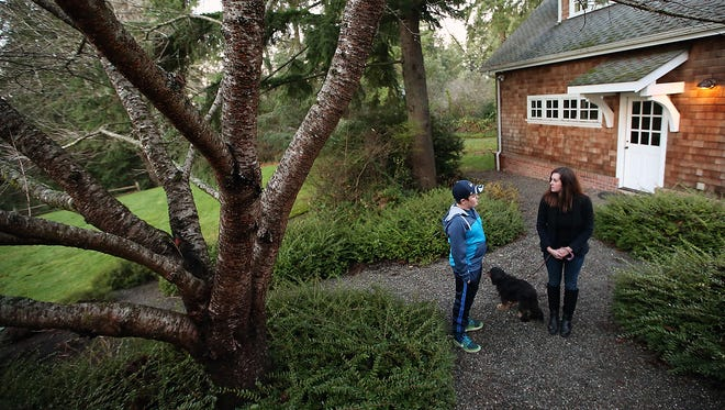 Charlie Odermat, 12, and his mother Regina Bellody talk about the recent attack that killed one of their dogs in the yard of their Bainbridge Island home.