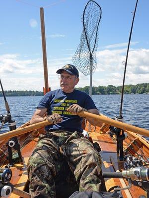 Patrick Durkin rows his cedar-strip rowboat on Lake Wissota near Chippewa Falls.