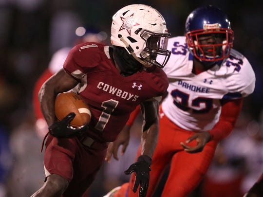 Madison's Derrick Staten Jr. runs the ball against Pahokee during their state semi-final playoff game at Madison County High School on Friday, Nov. 24, 2017.