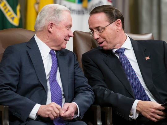 Attorney General Jeff Sessions, left, and Deputy Attorney General Rod Rosenstein, talk during an event to announce new strategic actions to combat the opioid crisis at the Department of Justice's National Opioid Summit in the Great Hall at the Department of Justice on Oct. 25, 2018, in Washington.