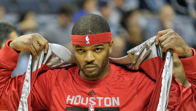 Houston Rockets forward Josh Smith (5) wamrs up before an NBA basketball game Friday, Dec. 26, 2014, in Memphis, Tenn.