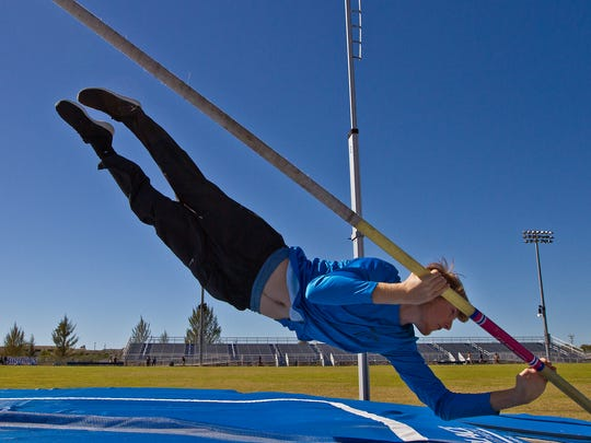 Drayton Diggs, of Ida Baker HS in Cape Coral, braces for landing while pole vaulting during a track and field practice Wednesday afternoon (2/17/16).