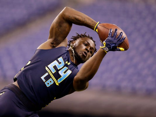 FILE - In this March 6, 2017, file photo, linebacker Jabrill Peppers makes a catch as he runs a drill at the NFL football scouting combine in Indianapolis. With safeties such as LSU's Jamal Davis and Ohio State's Malik Hooker available, the former Michigan star and Heisman Trophy finalist might slip out of the first round of the NFL Draft. (AP Photo/Michael Conroy, File)