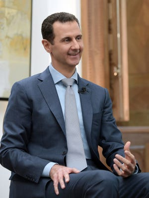A handout photo made available by the Syrian Arab News Agency (SANA) on Feb. 10, 2017 shows Syrian President Bashar Assad speaking during an interview with Yahoo News in Damascus, Syria.