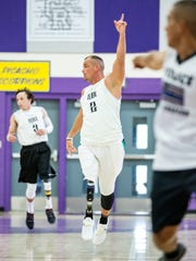 Amputee Basketball Invigorated co-founder Scott Odom, center, looks for the ball on Saturday August 18, 2017, during Team Manny's Hoops for Hope fundraiser at Camino Real Middle School. During the event LCPD's basketball played against Amputee Basketball Invigorated. Odom was diagnosed with cancer when he was 14, he chose to have his right leg amputated above the knee to not only save his life but to return to sports.