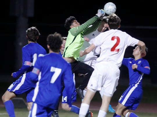 Palm Desert High School's players try to score against Temescal Canyon during their CIF match at Palm Desert on February 21, 2018.