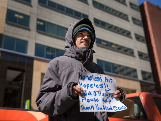 March 22, 2017: Homeless, DCI, downtown, Cincinnati, panhandlers, Liz Dufour