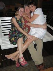 Birthday girls Dorothy Long and Robin Clawson flank