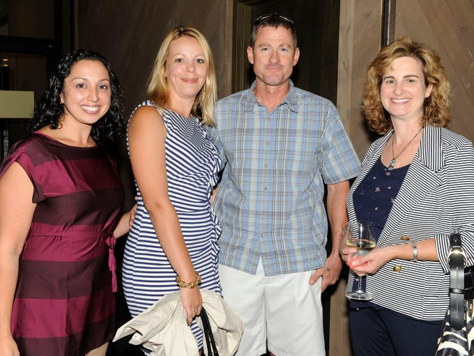 Seema Donahoe, left, Eugenia Lamore, Brian Bonnenfant and Bonnie Drinkwater attend the launch party for the September/October issue of Reno Magazine Thursday, Sept 4, 2014 at Whitney Peak.
