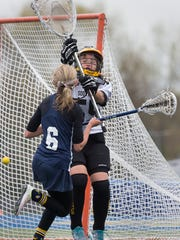 Toms River NorthÕs Courtney Kohler watches as one of her goals enters the net against Southern goalie.  Southern Regional vs Toms River North Girls Lacrosse in Toms River, NJ on May 5, 2016