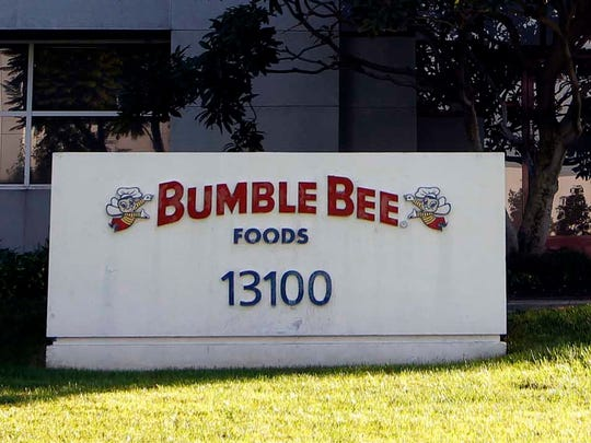 FILE - This Oct. 15, 2012, file photo shows the front of the Bumble Bee tuna processing plant in Santa Fe Springs, Calif. The AP reported on June 9, 2017, that a story claiming that a recall of Bumble Bee tuna was prompted by the Oct. 2012 death of a worker at the plant is a hoax. (AP Photo/Nick Ut, File)