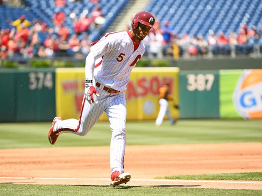 Nick Williams rounds third after hitting his first major league home run on Sunday.